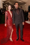 Rose Byrne in a red lasercut deep-v Calvin Klein Collection dress & Bobby Cannavale at the 2015 Met Gala. 01.
