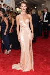 Rosie Huntington-Whiteley in a gold single-shoulder high slit gold Versace gown at the 2015 Met Gala. 01.
