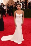 Selena Gomez in a white cut-out spaghetti strap gown by Vera Wang at the 2015 Met Gala. 01.