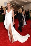 Uma Thurman in a white single-sleeve high slit Atelier Versace gown at the 2015 Met Gala. 01.