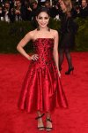 Vanessa Hudgens in a red beaded tea length H&M dress at the 2015 Met Gala. 01.