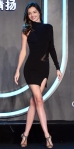 Miranda Kerr in a one-sleeve geometric LBD by Self-Portrait & mesh cut-out booties a Clear shampoo promotional event.