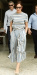 Victoria Beckham in a striped top & coordinating culottes from Victoria Beckham's Autumn Winter 2015 collection with nude pumps in NYC.