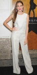 Allison Williams went head-to-toe white in a matching brocade top & trousers with pink teardrop earrings at the Broadway opening of Hamilton.