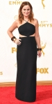 Amy Poehler in a black cut out gown by Michael Kors.