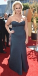 Amy Schumer in a hunter green strapless sweetheart Zac Posen design.