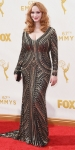 Christina Hendricks in a long sleeve embellished metallic gown by Naeem Khan.