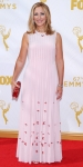 Edie Falco in a pink pleated Prada gown.