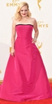 Elisabeth Moss in a hot pink strapless ball gown by Oscar de la Renta.
