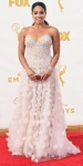 Gina Rodriguez in a blush embellished sweetheart Lorena Sarbu gown.