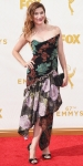 Kathryn Hahn in a black floral embroidered gown with ankel strap heels & a black clutch.