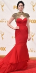 Laura Prepon in a red & gold embellished dress by Christian Siriano.