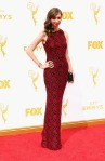Lauren Lapkus in a red & black lace column gown.