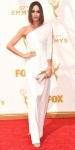 Louise Roe in a white one-shoulder column gown with a gold rectangular clutch.
