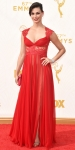 Morena Baccarin in a red Grecian lace Reem Acra with Harry Kotlar diamond earrings.