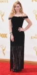Natasha Lyonne in a black off the shoulder fringe dress.