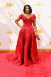 Niecy Nash in a red embellished off the shoulder gown.