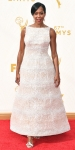 Regina King in a white beaded tea length gown.