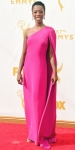 Samira Wiley in a one-shoulder hot pink caped gown.