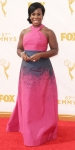 Uzo Aduba in a color block printed pink & black gown by Jonathan Cohen.