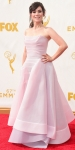 Yael Stone in a pale pink corseted ball gown.