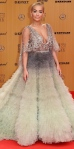 Rita Ora stunned in a mint & gray ombre tulle & floating ball gown by Marchesa for the 2015 Bambi Awards.
