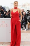 Blake Lively in a red faux-dress jumpsuit by Juan Carlos Obando at the Cannes Film Festival.