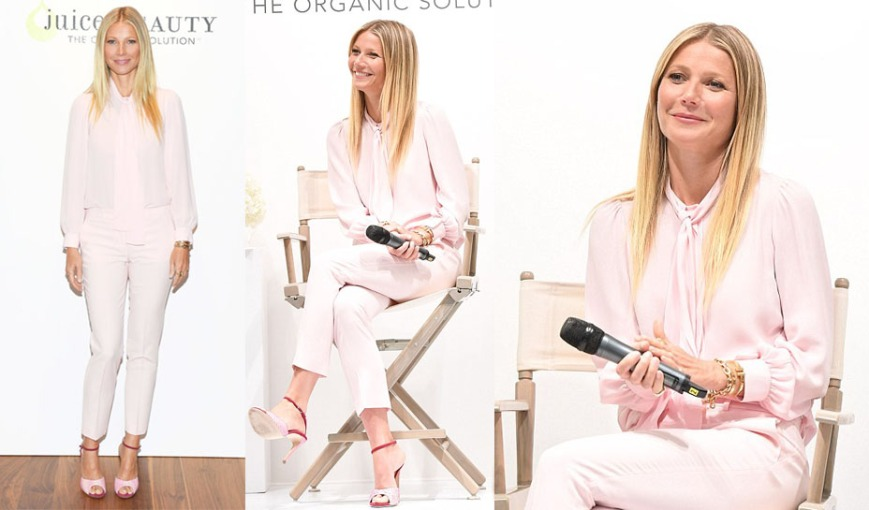 Gwyneth Paltrow in a blush silk bow blouse & skinny pants by Michael Kors Collection with pink croc Chloe Gosselin sandals at a Juice Beauty by goop event in Toronto.