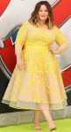Melissa McCarthy in a yellow lace floral embroidered 50s inspired A-line dress by Judith B Schwartz & Daniela Kurrle with strappy cream Aldo sandals at the Ghostbusters premiere.